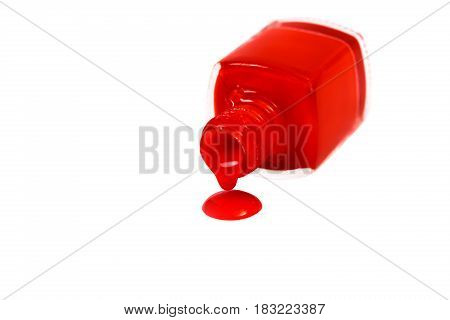 red nail Polish spilled isolated on the white background