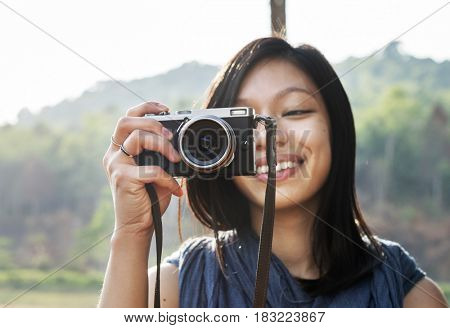Girl Taking Pictures Outdoors Concept