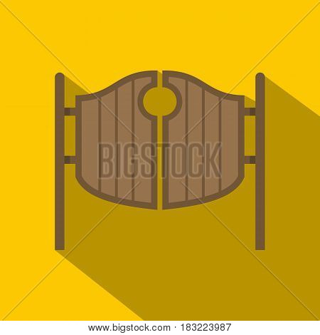 Vintage western swinging saloon doors icon. Flat illustration of vintage western swinging saloon doors vector icon for web on yellow background