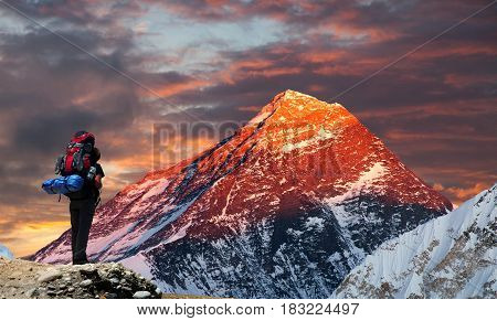 Evening colored view of Mount Everest from Gokyo valley with tourist on the way to Everest base camp Sagarmatha national park Khumbu valley Nepal