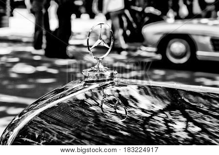 """BERLIN - MAY 28: Mercedes-Benz symbol on the hood (Black and White) the exhibition """"125 car history - 125 years of history Kurfurstendamm"""" May 28 2011 in Berlin Germany"""