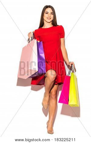 Beautiful Attractive Woman With Color Shoping Bags In Hands On White Background. Summer.