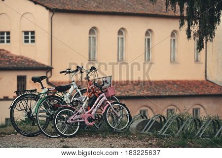 LUCCA - MAY 19: Bikes with old church on May 19, 2016 in Lucca, Italy. It is famous for its well preserved Renaissance-era city walls and the tourism location.
