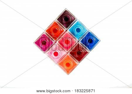 group of nail Polish isolated on the white background. top view