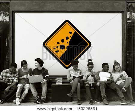 Group of Friends Sitting with Rockfall Beware Attention Behind
