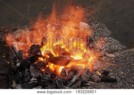 Fragment of the furnace for heating metal blanks on hot coals before forging