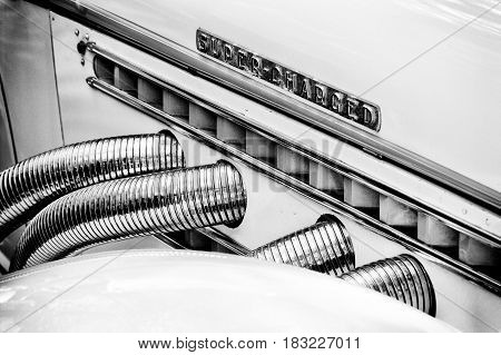 "BERLIN - MAY 28: Exhaust pipes Auburn 851 Supercharged speedster (Black and White) the exhibition ""125 car history - 125 years of history Kurfurstendamm"" May 28 2011 in Berlin Germany"