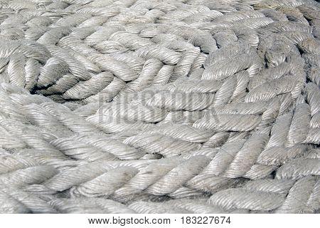 Gray nautical rope closeup background texture. Foto
