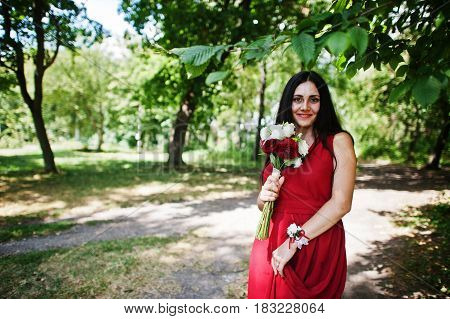 Cute Girl Bridesmaid At Red Dress With Wedding Bouquet At Hand.