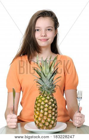 Pretty Young Girl Is Sitting At The Table And Preparing To Eat Pineapple.