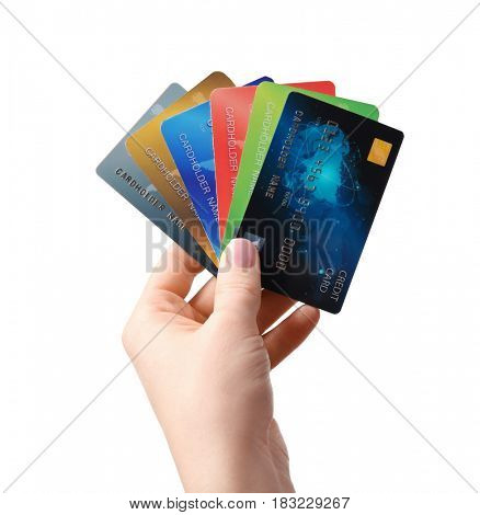 Female hand holding credit cards on white background