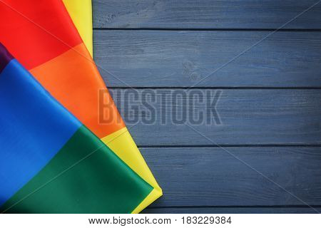 Rainbow gay flag on wooden background