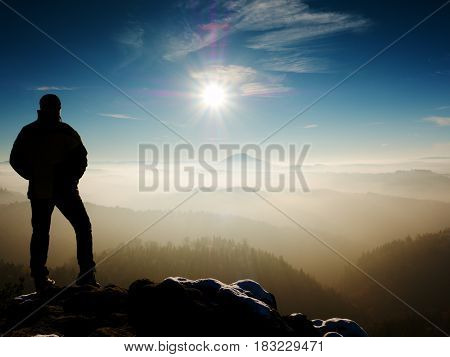Man Silhouette On Sharp Peak. Satisfy Hiker Enjoy View