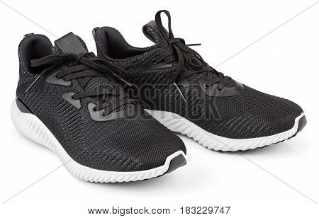 Pair of new unbranded black sport running shoes sneakers or trainers isolated on white background with clipping path