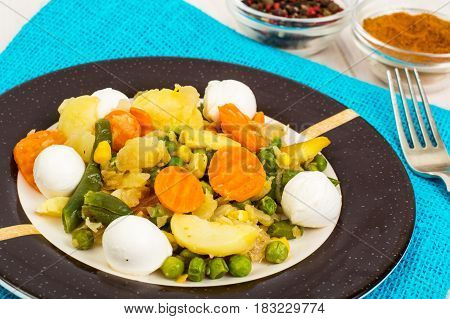 Vegetable saute with mozzarella on plate. Studio Photo