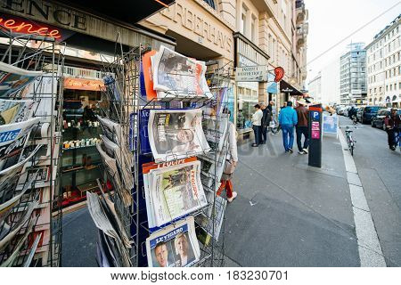 PARIS FRANCE - APRIL 24: International newspapers at press kiosk wih newspaper and pictures of French Presidential election candidates Emmanuel Macron Marine Le Pen a day after first round of French Presidential election on April 23 2017