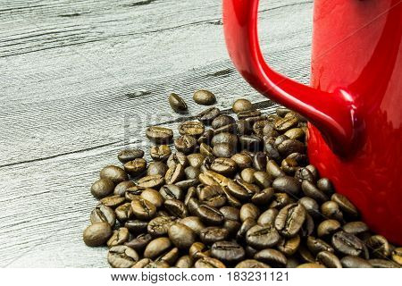 coffee grains with cup on grunge wooden background