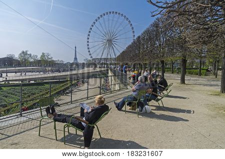 PARIS FRANCE - MARCH 26 2017: People are resting in the Tuileries garden on a spring sunny day. Paris France.