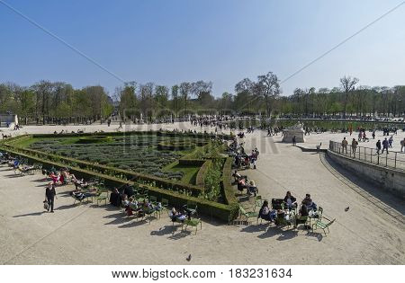PARIS FRANCE - MARCH 26 2017: Resting people in the Tuileries garden on a spring sunny day. Paris France.