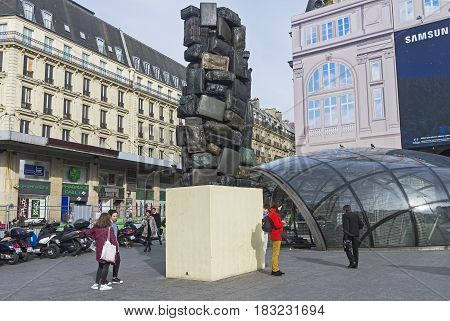 PARIS FRANCE - APRIL 1 2017: A piece of modern art - а column of suitcases. The square at the Saint-Lazare railway station in Paris France.