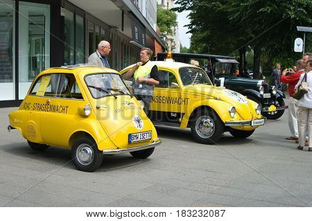 BERLIN - MAY 28: A small vehicle BMW Isetta 300 (ADAC) and the Volkswagen Beetle (ADAC) the exhibition