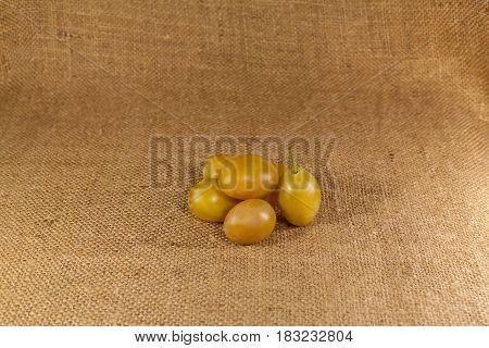 The ripe plum lies on the cloth