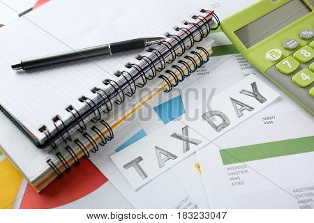 Card with text TAX DAY and calculator on documents