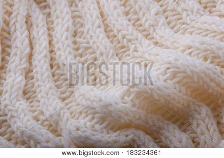 Backdrop. Closeup of white wool knitwear with waves