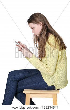 Young Girl Holds A Smartphone In Her Hands On A Clean White Background.