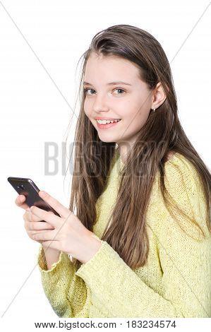 Smiling Teenage Girl Holding Smartphone In Hands.