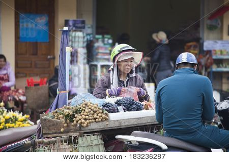 Sa Pa, Vietnam - March 15, 2017: Scene from a misty day at the market in Sapa. Sapa is famous for its rugged scenery and its cultural diversity.