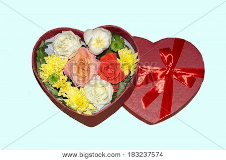 Gift box in the form of a heart with roses chrysanthemums and tulips on a gentle background