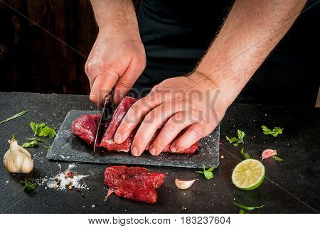 Man Cooking Beef Meat