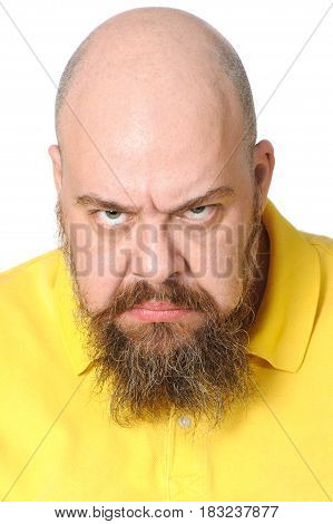 Portrait Of An Angry Bearded Man Close-up On A Clean White Background..