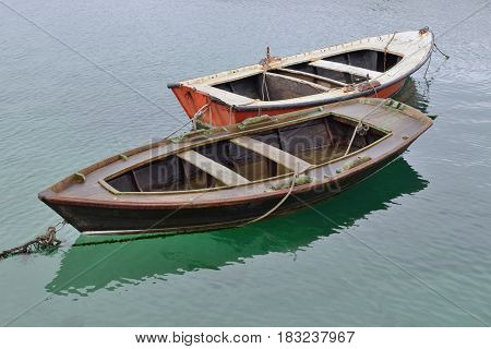 two wooden fishing boats on the water