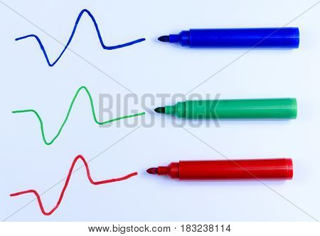 Hand drawn blue green and red line and pens isolated on a white background