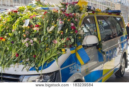 STOCKHOLM, SWEDEN - April 09, 2017: Flowers on a police van. truck attack in central Stockholm, Sweden.