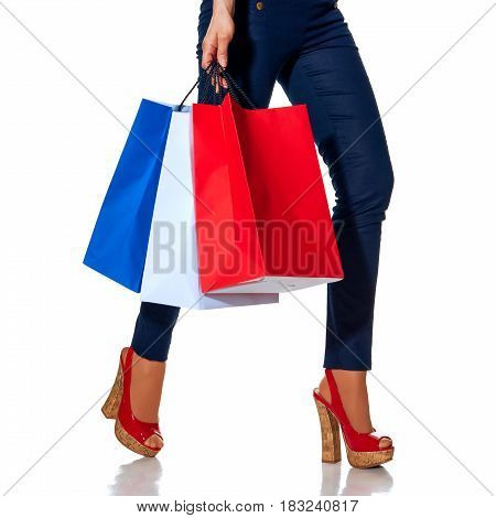 Closeup On Fashion-monger Walking With Shopping Bags On White