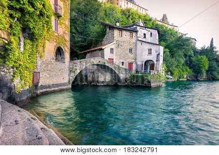Old stone bridge at the end of Nesso's ravine Como Italy