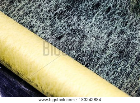Interfacing Textile Fabric Rolled Up On A Black Background