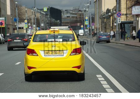 Moscow Russia - April 24 2017: Yellow taxi on the Moscow street