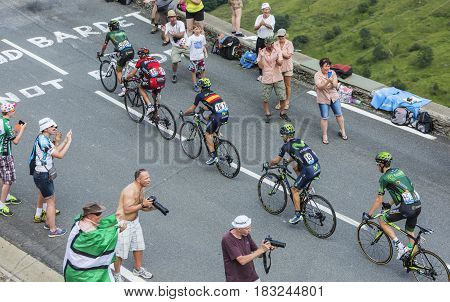 Col de PeyresourdeFrance- July 23 2014: Five cyclists Yukiya Arashiro Pierre Rolland (Europcar Team) Peter Velits (BMCTeam) Jon Izagirre Insausti Giovanni Visconti (Movistar Team) climbing the road to Col de Peyresourde during Tour de France 2014.