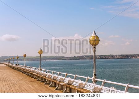Empty pier over the ocean bay beautiful blue ocean pane blue sunny sky wooden pier wooden pier