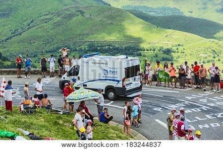 Col de PeyresourdeFrance- July 23 2014: The official ambulance climbing the road to Col de Peyresourde in Pyrenees Mountains during the stage 17 of Le Tour de France on 23 July 2014.