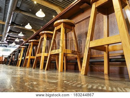 wooden bar stools in a row, bottom view