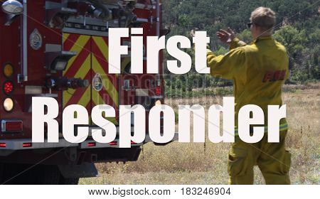 Fire fighter helping fire truck back up on road in response to wildfire