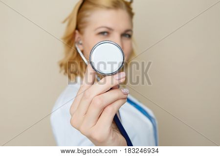 Doctor with phonendoscope in hands