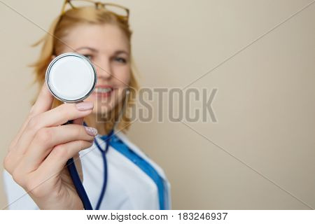 Blonde in glasses with phonendoscope