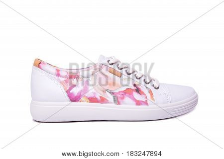 Ladies Pink Sneakers On A White Background