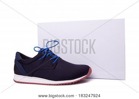 One Of Blue Mens Sport Shoes Near The White Box. Isolate On White.